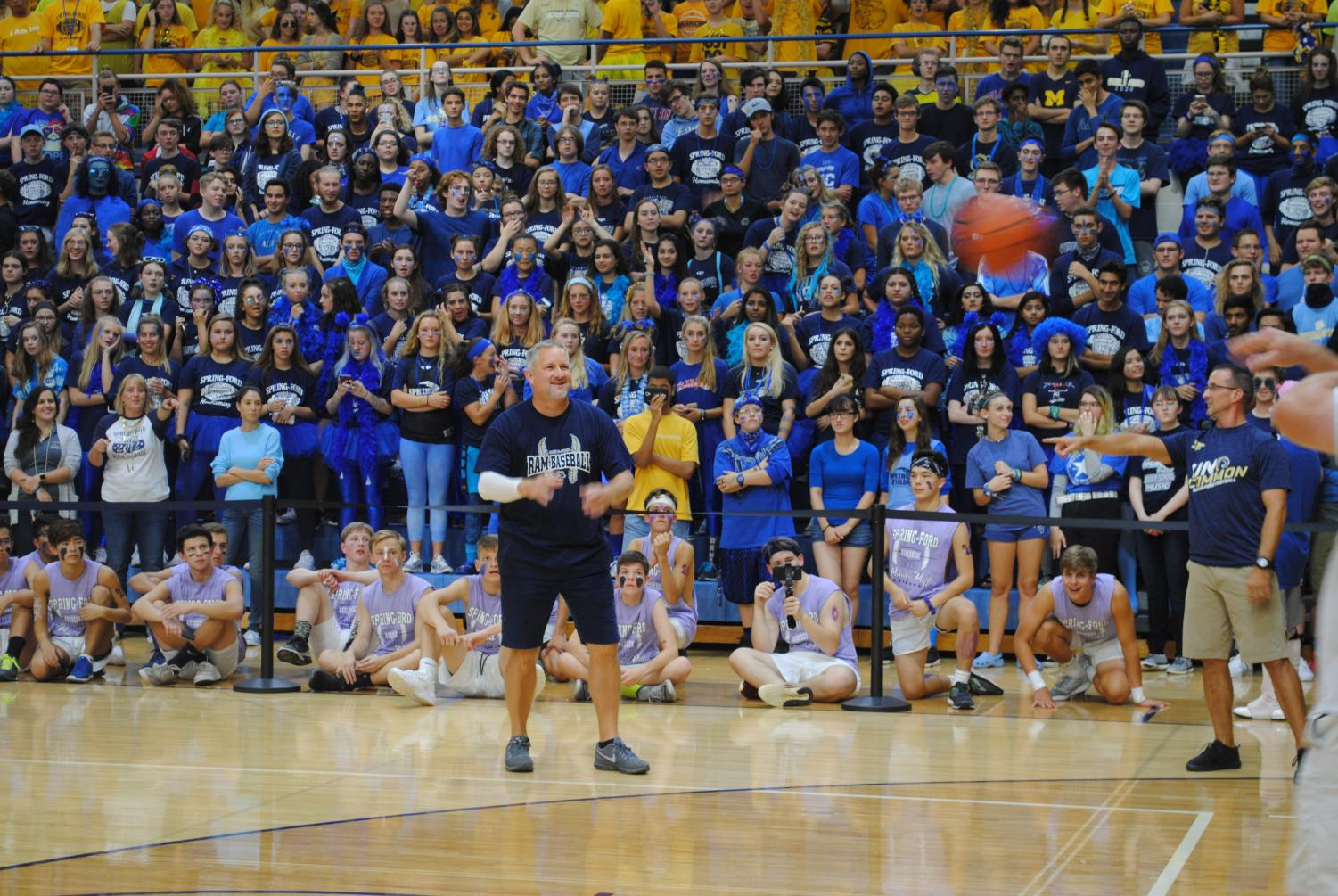 Teachers Jamie Scheck (left) and Jim Mich take part in the three-point contest during the Pep Rally.
