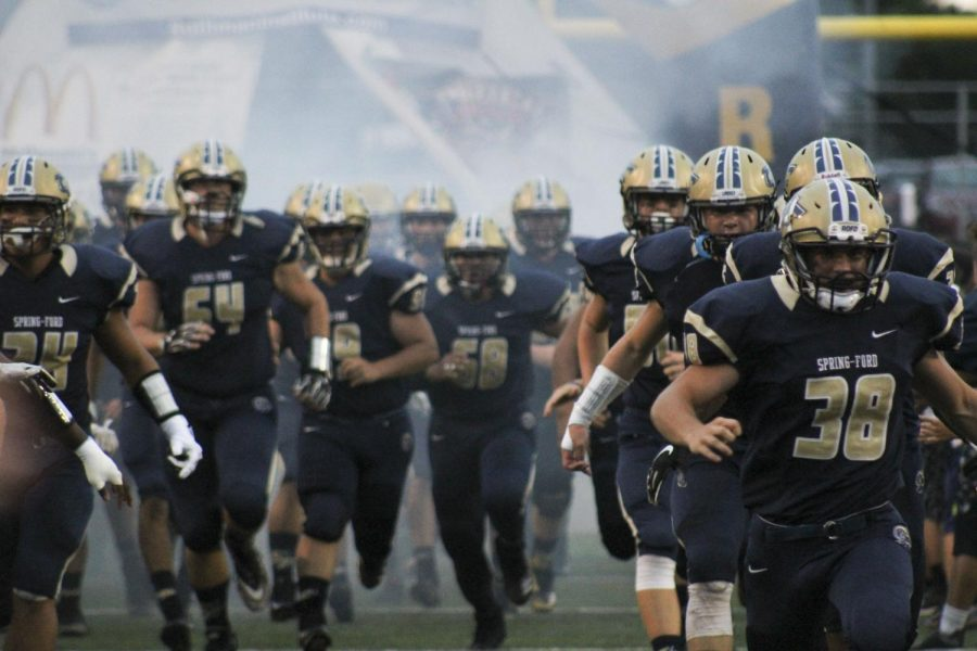 Spring-Ford+football+players+take+the+field+before+a+game+earlier+this+season.+The+Rams+finished+the+season+with+a+8-2+regular+season.+
