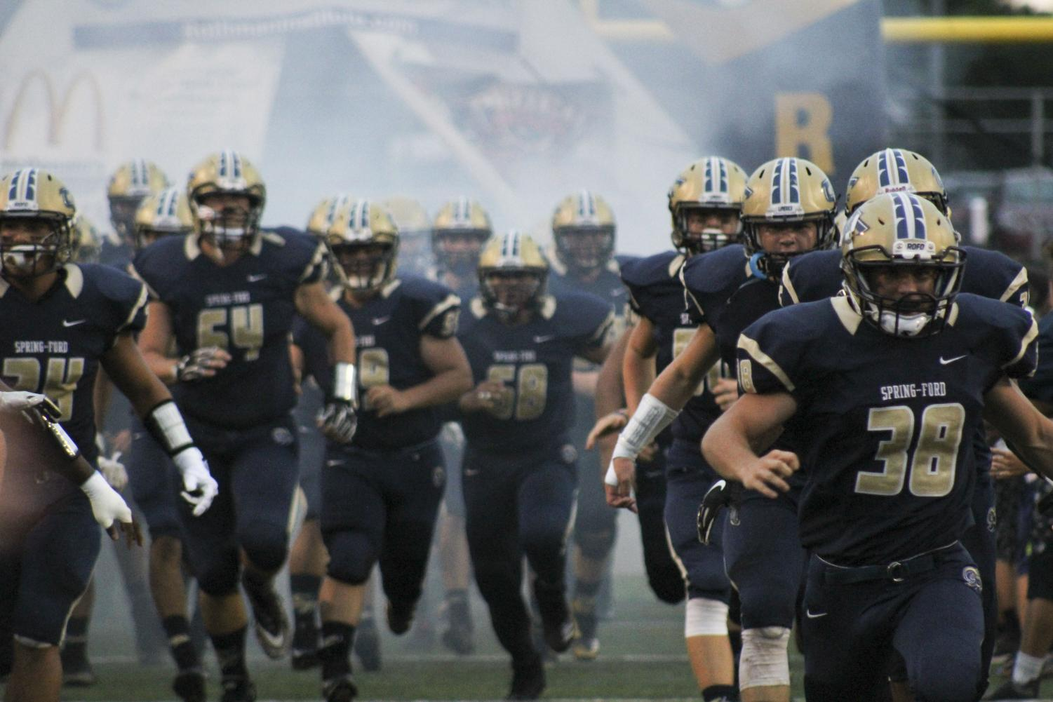 Spring-Ford football players take the field before a game earlier this season. The Rams finished the season with a 8-2 regular season.