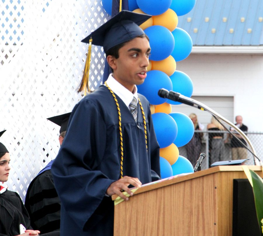 Yash+Shah+delivers+the+valedictorian+speech+at+2018+Commencement+last+June.