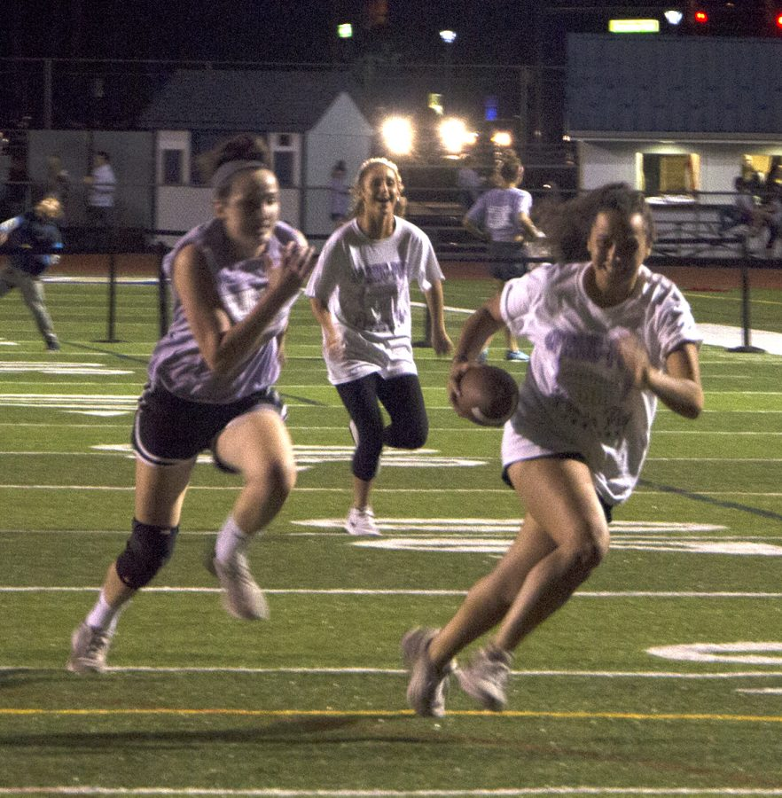 Sarah+Derosa+carries+the+football+during+the+Powderpuff+game.+