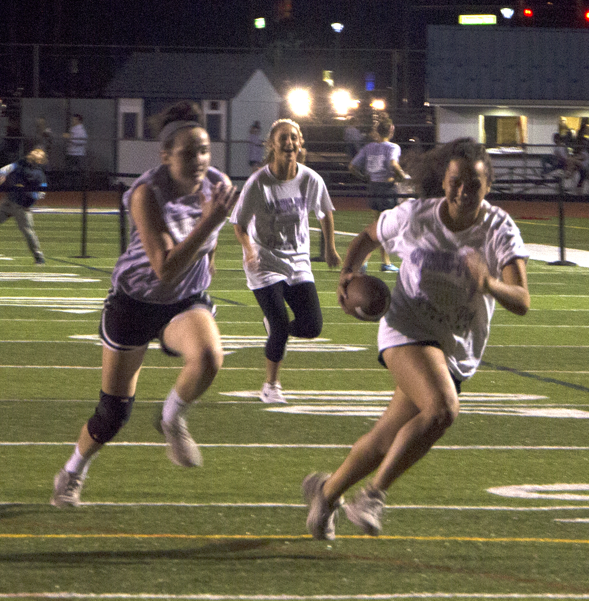 Sarah Derosa carries the football during the Powderpuff game.