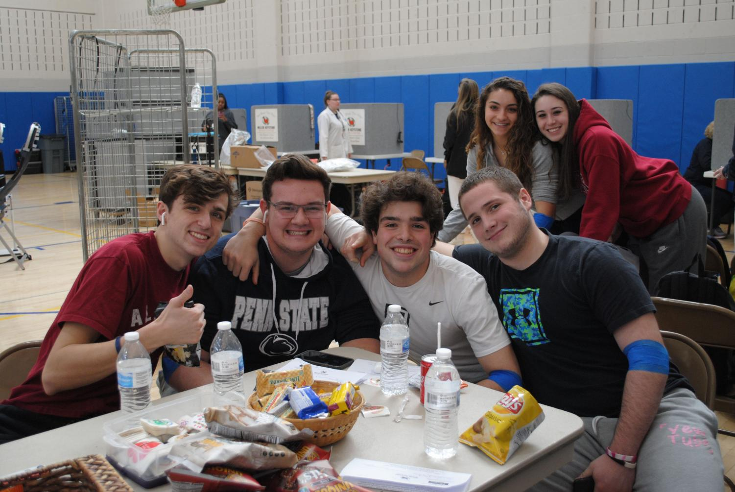 Spring-Ford students (from left) Joe Morgan, Cody Lutz, Gunnar Romano, Peyton Gensler, Mandie Pierce, and Lexy Hammer take part in the school's blood drive.