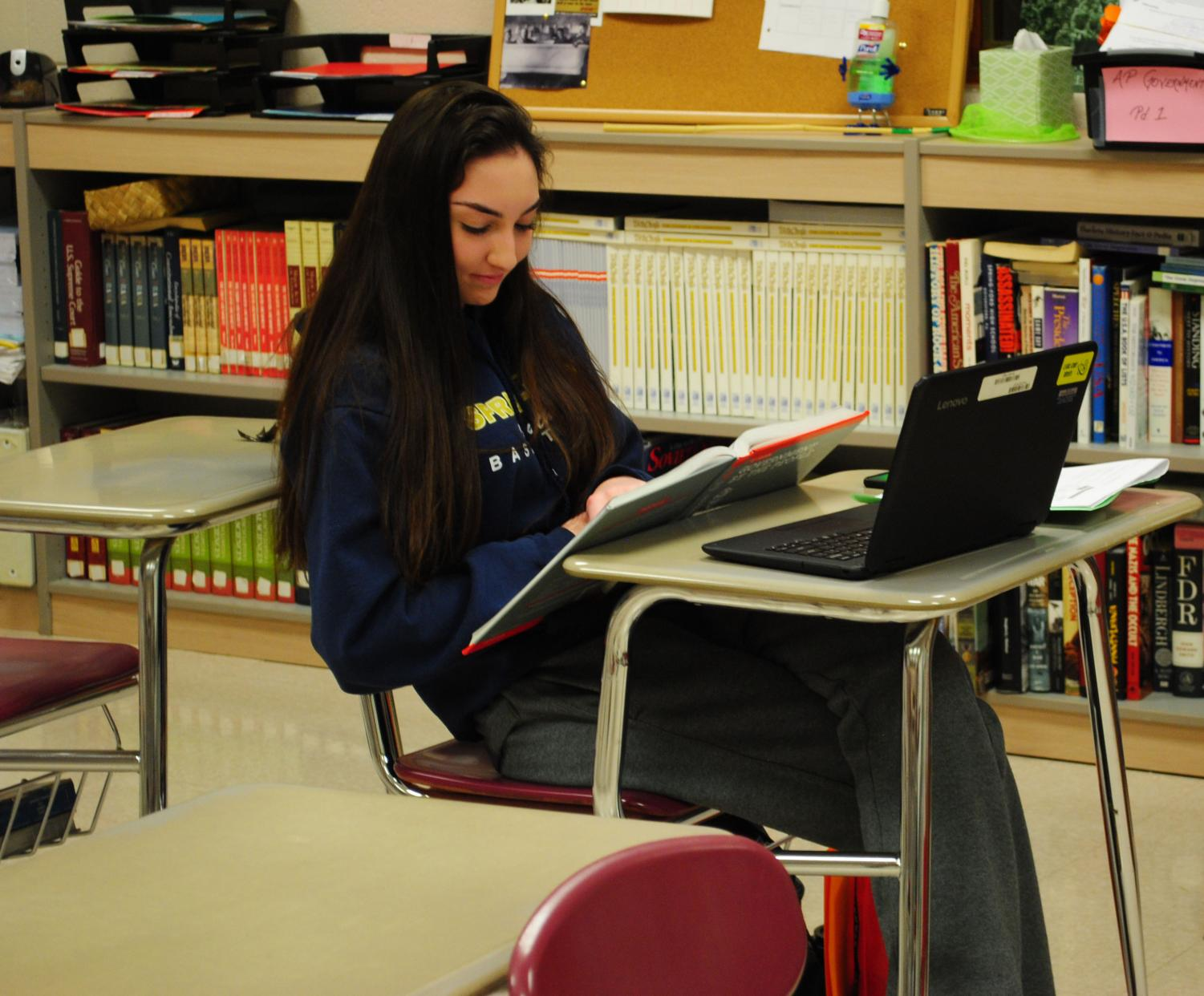 Olivia West uses the Lenovo laptop to help her studies in teacher Stacey Bogus' AP Government and Politics  class.