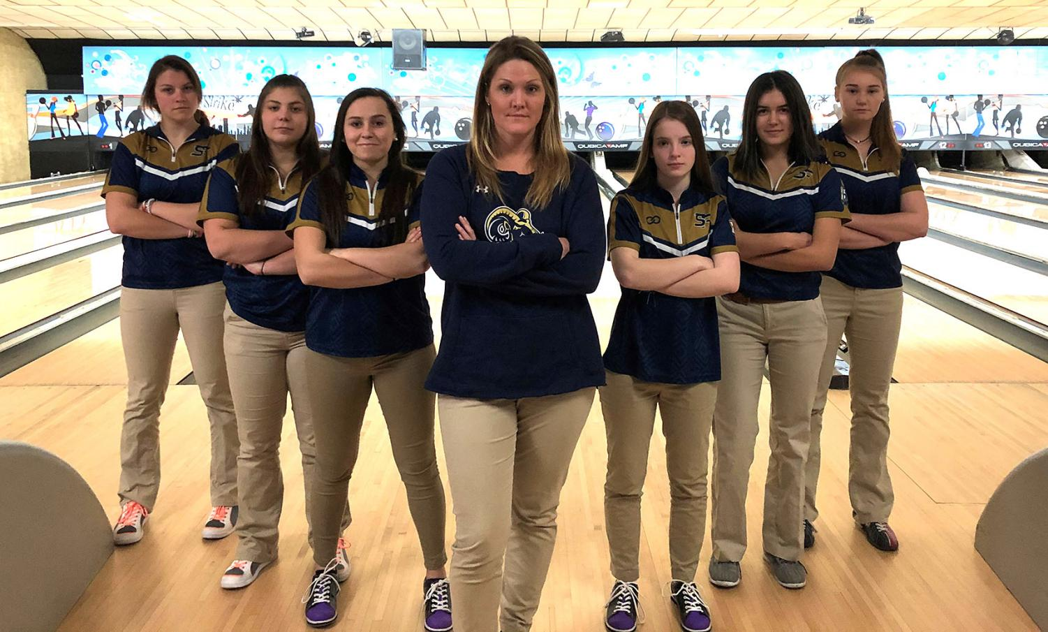 The Spring-Ford girls bowling team poses for photos during their inaugural season at Limerick Bowl. Pictured at center is coach Mallory Greene.