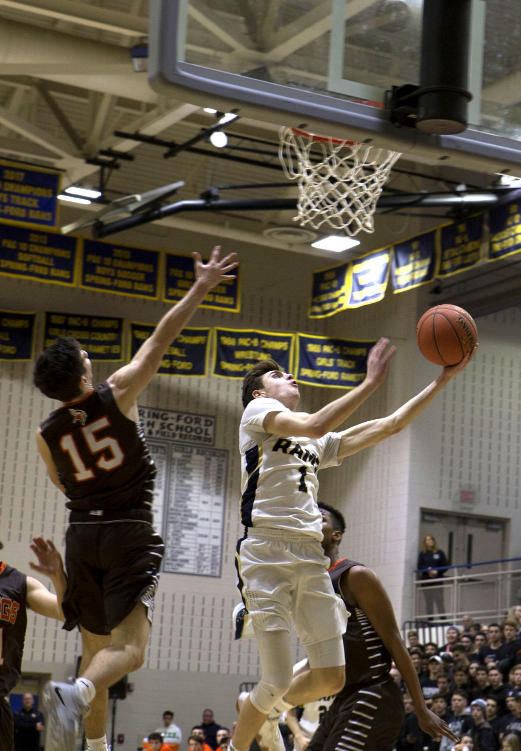 Junior basketball  player Michael  Fitzgerald goes up for a lay-up against  Perkiomen Valley this year.