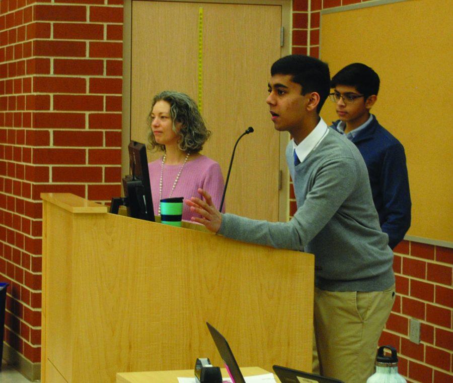 Below, moderators Deepak Kejariwal and Rahil Mehta address students with teacher Julie Korchowsky.