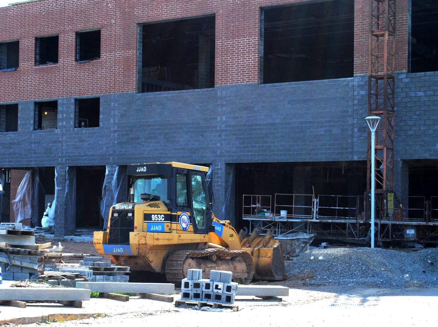 Construction crews work on the fitness center extension in the back of the high school during the spring.