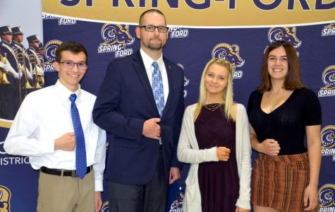 History teacher Brad Seltzer poses with students during the Impact Awards.
