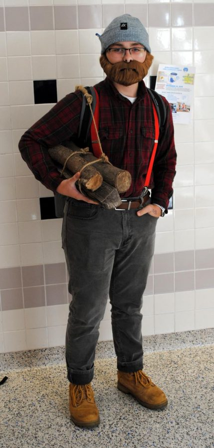 A lumberjack walks through the halls on Superhero/Rock Star/Celebrity Day during Spring-Ford's Spirit Week.