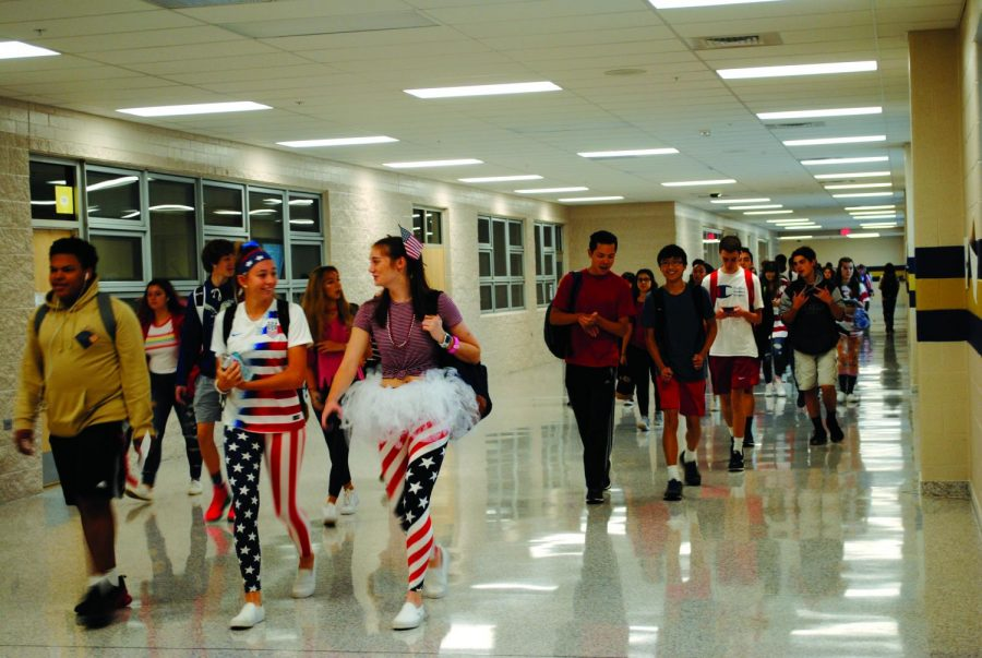 Students walk down the hall during the annual Team USA Day event at the high school.