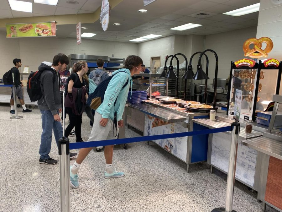 Students peruse the offerings at the remodeled cafeteria. A deli station and pizza station are among the changes students are excited about this year.