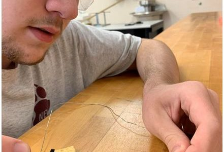 Brett Volker works on circuitry in preparation for the Space Balloon payload project.