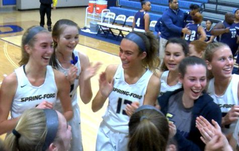 Spring-Ford basketball player Lucy Olsen (left) is greeted by teammates after scoring her 1,000th point in an 85-15 victory over Pottstown.