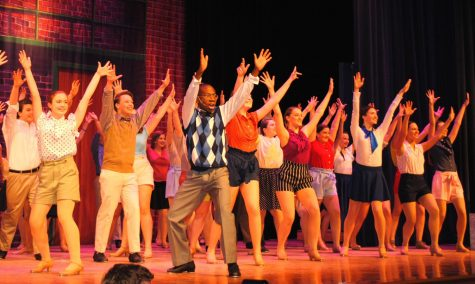 "Actors perform a tap dance routine at the beginning of Spring-Fords musical ""42nd Street."""