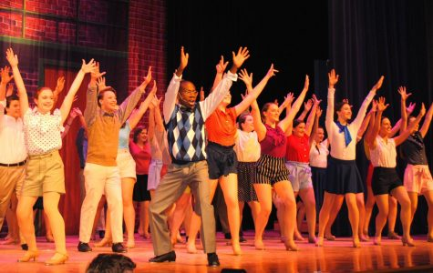 Actors perform a tap dance routine at the beginning of Spring-Fords musical