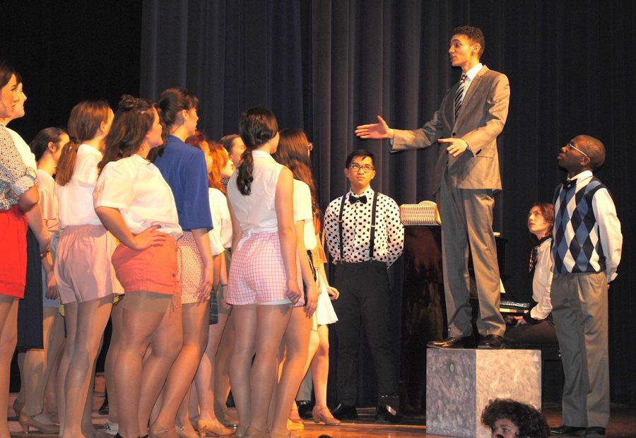 Nate Warren, as Julian Marsh, instructs his dancers in