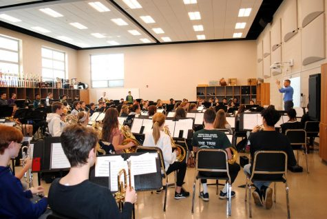 Spring-Ford music student rehearse during the school day with director Seth Jones (right).