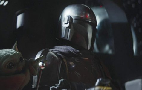 "The Mandalorian and ""The Child,"" who resembles fan favorite Yoda, are pictured in the Disney + Star Wars spin-off ""The Mandalorian."""
