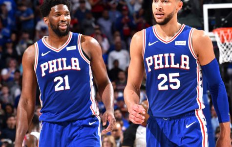 Sixers players Joel Embiid (left) and Ben Simmons are expected to travel to Disney's ESPN Wide World of Sports Complex in Orlando, Fla., when the NBA resumes play in July.  The plan is that the top 22 teams will play games in Orlando and then take part in a 16-team playoff.