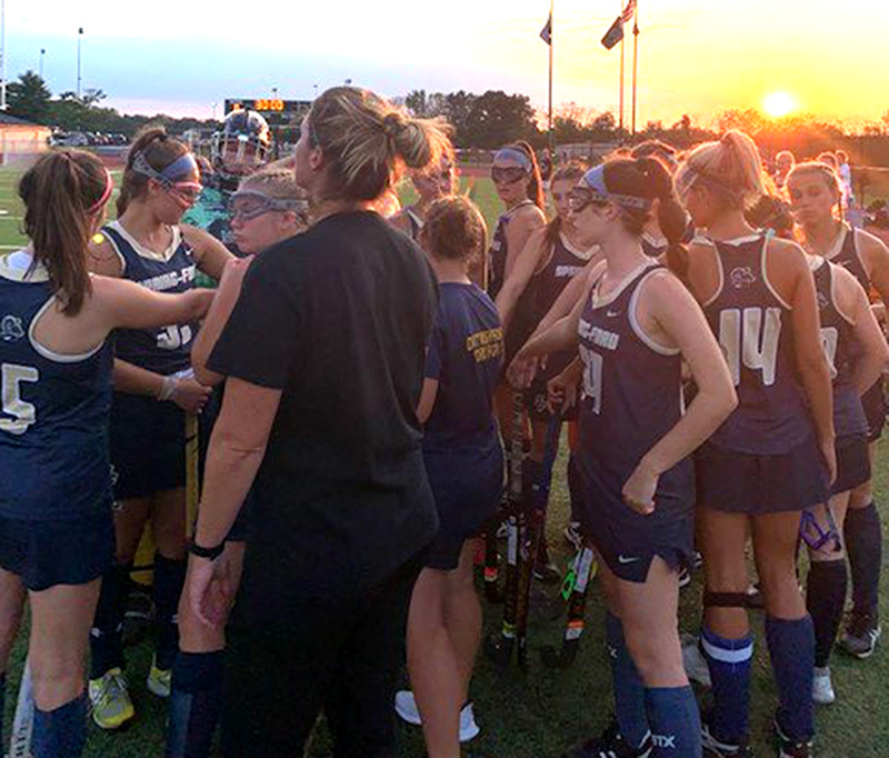 Spring-Ford field hockey coach Jennie Anderson, center, speaks with her team last fall.