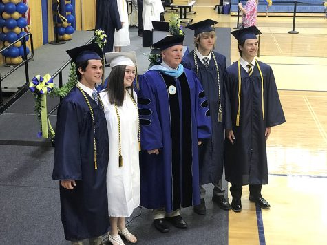 Spring-Ford High School Principal Dr. Patrick Nugent, center, poses with students at graduation this spring. Nugent will be retiring as principal August 7. Nugent has worked in the district the past 36 years as a teacher, coach, assistant principal, and as principal of the high school the past 18 years.