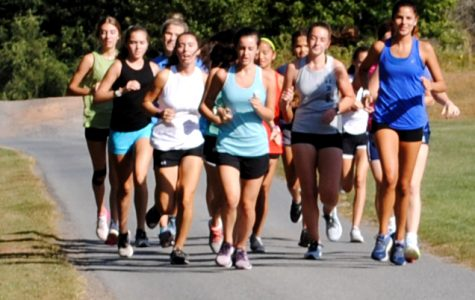 The girls cross country team trains Sept. 23 on campus.