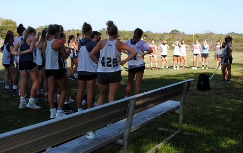 Coach Jennie Anderson (right) addresses the field hockey team Wednesday, Sept. 23.