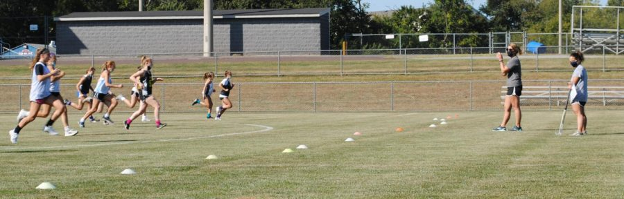 The field hockey team works through running drills prior to practice Sept. 23.