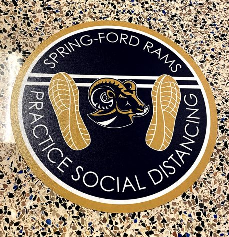 A social-distancing sign is seen outside the cafeteria at Spring-Ford Area High School. Signs like these are just some of the safety measures implemented during the schools hybrid return.