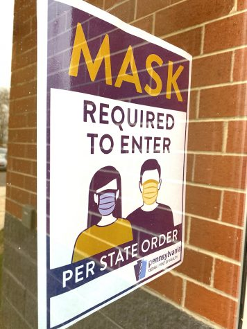 A sign is displayed at the 10-12 Center encouraging students to wear masks prior to entering the building.