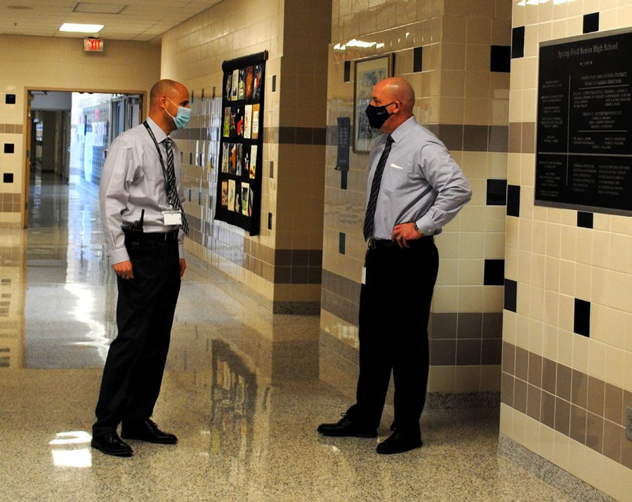 11th-Grade House Principal David Krakower (left) speaks with 10-12 Building Principal Dr. Robert Colyer.