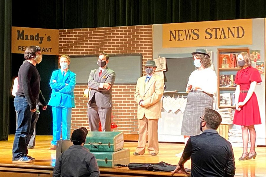 """Spring-Ford play director Alex Cifelli (foreground, left) directs actors during preparation for the performance of """"Guys and Dolls,"""" set to take place later this spring."""