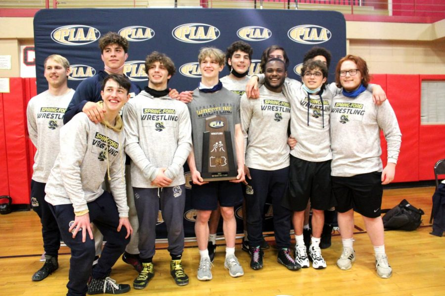 Spring-Ford's senior wrestlers celebrate with the program's first-ever third-place trophy at the PIAA Class AAA Team Championships on Saturday.
