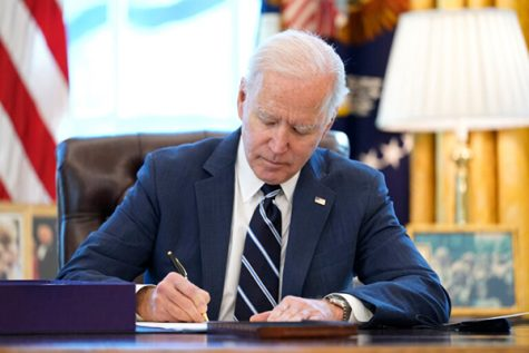 President Joe Biden signs the $1.9 trillion COVID-19 relief bill.