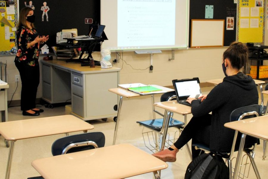 Psychology teacher Susan Miscavage instructs her virtual and in-person students during class on April 13.