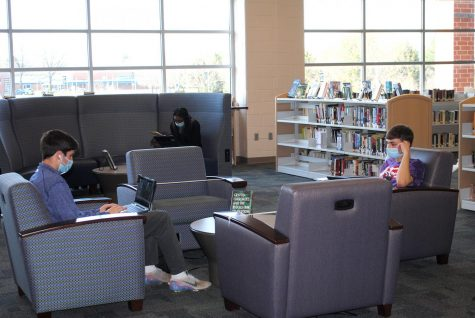 Spring-Ford students (from left) Joe Brogan, Destiny Barnes, and Anthony Sharpe study in the media center while socially distanced.