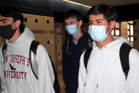 Seniors (from left) Anthony Bamford, Matt Dunne, and John Zawislak walk down the hall outside the media center.
