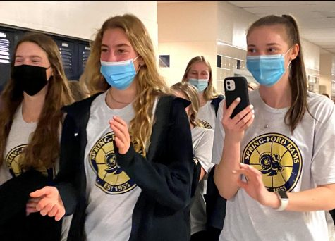 Spring-Ford girls basketball players walk through the hall during a socially-distanced pep rally.