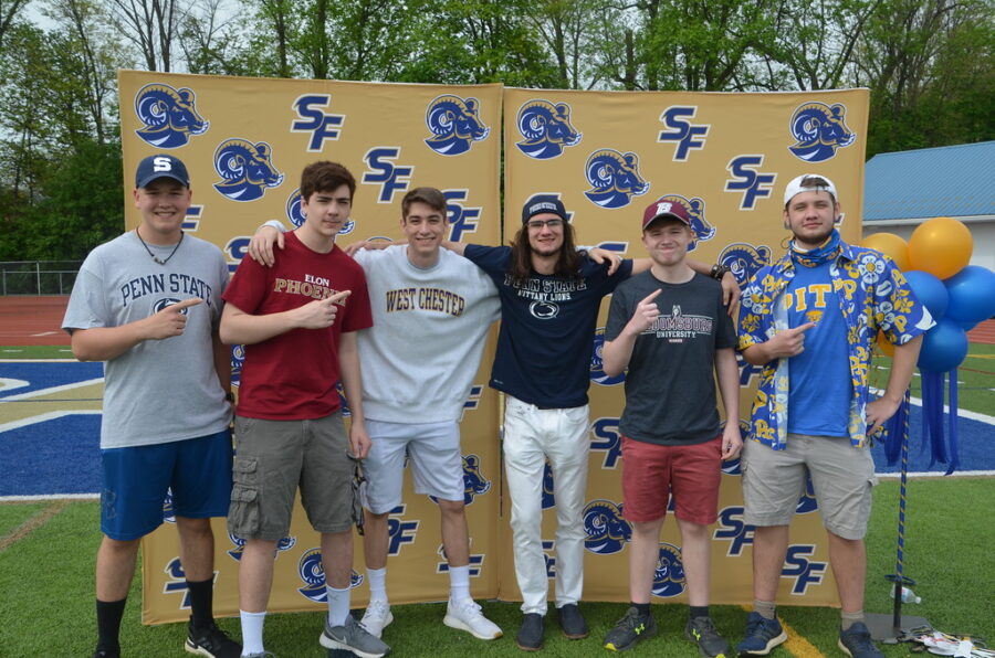 Spring-Ford+seniors+%28from+left%29+Matthew+Miller%2C+Nathan+Romano%2C+Gabe+Flad%2C+Kenny+Butler%2C+Brandon+Young%2C+and+Jason+Adelhelm+celebrate+during+Decision+Day+ceremonies.+
