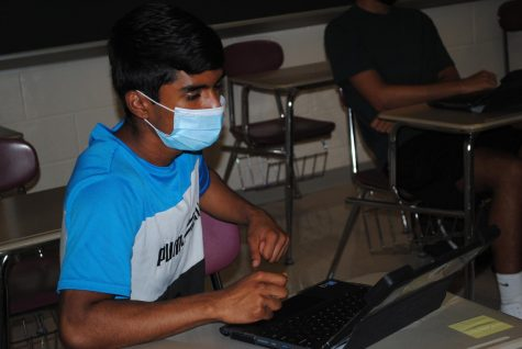 Spring-Ford junior Jihan Raiyan completes an assignment in English class. Spring-Ford will offer five-day in-person and cyber options for learning next school year.